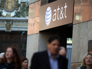 AT&T raises price on unlimited data plans