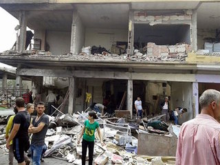Activists: Insurgents seize village near Aleppo
