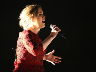Adele calls out fan for filming show