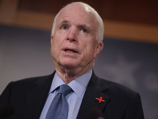McCain opposes health care bill, Flake supports