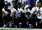 PHOTOS: Dozens of NFL players kneel for anthem