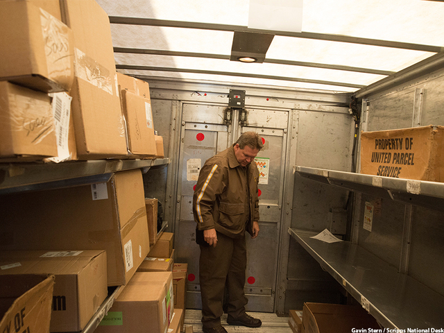UPS delivery driver veteran Greg Schneider looks for the right package during holiday deliveries.