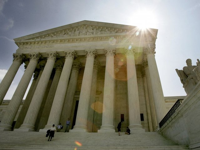 US Supreme Court takes up fight over Trump travel ban