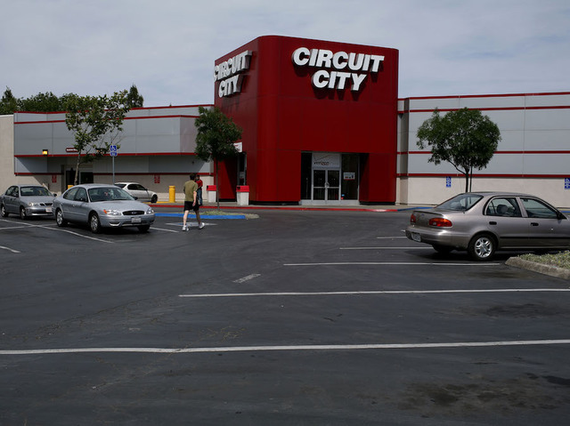 A Customer Walks Through Nearly Empty Parking Lot Outside Of Circuit City Store June 19 2008 In San Rafael California Reported First