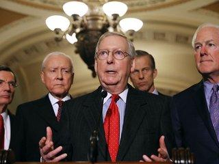Budget bill clears key procedural Senate vote