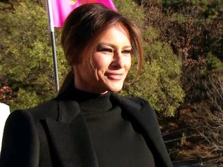Trump jokes 'I may get in trouble' with Melania